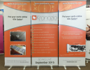 3 banner stands wall